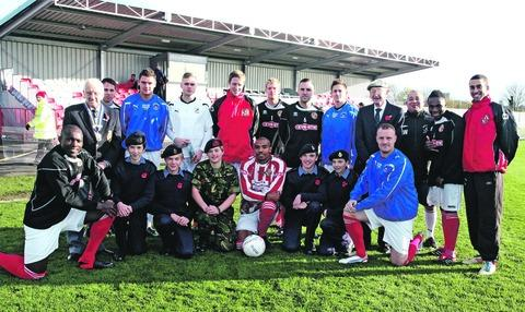 STADIUM: Members of Evesham United FC with local cadets aft er the club offered its new ground for the launch of the Poppy Appeal fund-raising drive in the region.