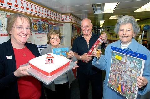 Cotswold Journal: ACHIEVEMENT: From left, shop manager Sue Allen, area organiser Lyn O'Toole and John and Pat Ogle mark 21 years of seasonal fund-raising. Picture: Nick Toogood. 44165802