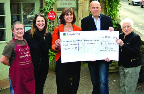 CHEQUE: Chris Grimes, Blockley Shop manager, left, with Ruth Mosley, chair of the ball committee, Kathy Illingworth, and shop committee members Ollie Lincoln and Margaret Bryan.