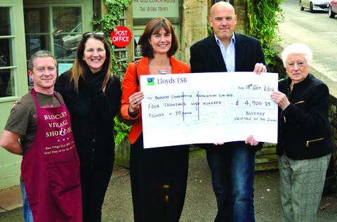 CHEQUE: Chris Grimes, Blockley Shop manager, left, with Ruth Mosley, chair of the ball committee, Kath