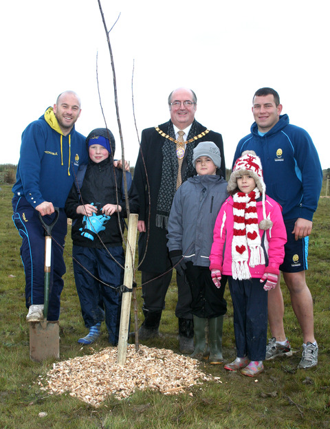BEARING FRUIT: Warriors Paul Hodgson and Ed Shervington with Coun Richard Morris and schoolchildren from the village Jamie Saunders, Luke White and Charlotte Pye.