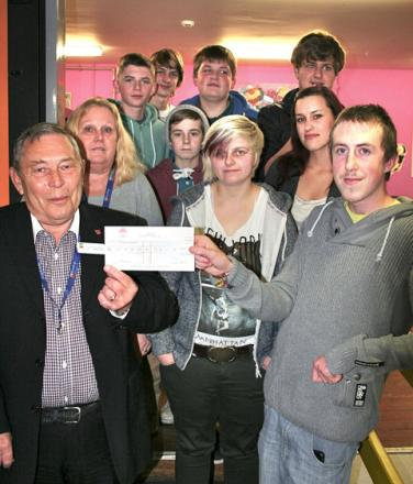 Robert and Sheila Kettley of Rooftop with some of the members of Evesham's Ourside Youth Centre