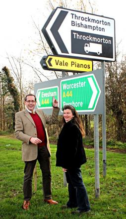 JUSTICE: MP Peter Luff and Vale Pianos owner Linda Stowe with the new sign that has been put up after eight years of wrangling.