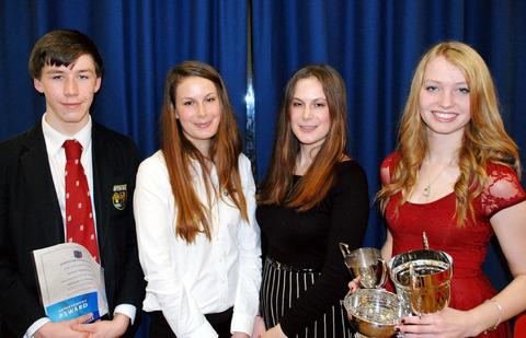 Cotswold Journal: TWINS: From left, senior prefect Jarrod Salmons with guests of honour Hattie and Sophie Taylor and year 11 leaver Kate Higginson at Shipston High School's awards evening.