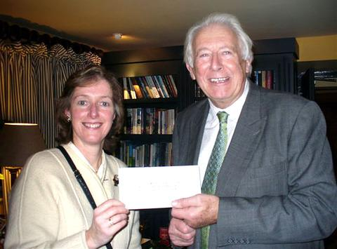 GENEROUS: Nigel Moor presents the donation to Alexia Monroe representing the North Cotswolds Foodbank.