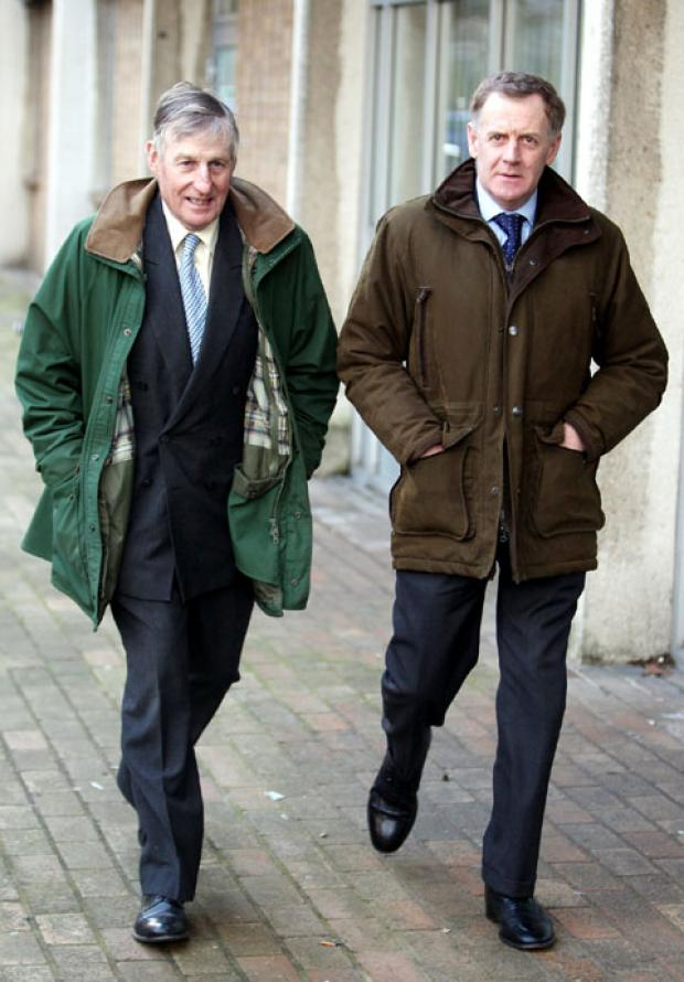 Former huntsman Julian Barnsfield, (right) and recently retired hunt master Richard Sumner (left) arrive at Oxford Magistrates Court