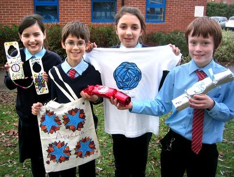 ENTREPRENEURS: St Nicholas CE Middle School pupils Nelly Ledger, Aidan Budd, Miriam Attias and Charlie Holland show off some of the products they have made and sold during their apprentice 'learning journey'.