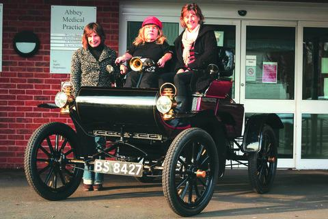 Former motor racing champion Joy Rainey, is gearing up to drive a 109-year-old classic car across America in memory of her late husband Trevor.