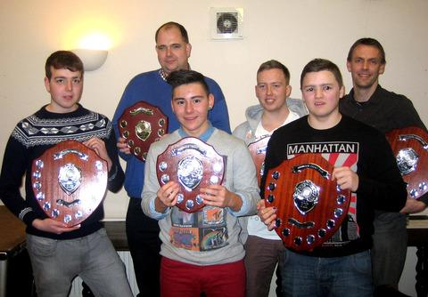 PROMOTION SUCCESS: Harvington award winners, back row (left to right): Simon Price (club captain), Andrew Fisher and Steve Mckelvie (collecting an award on behalf of Jo Venter). Front: Jethro Chadwick, Tom Heywood and Jaimen Rudd.