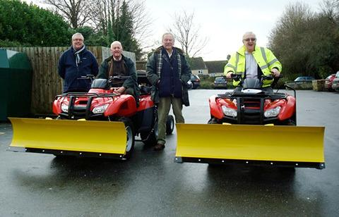PLOUGHING AHEAD: Pictured with the new snow ploughs are, from left, Chipping Norton snow warden Derek Dickinson, Mayor Martin Jarratt, Councillor Alex Corfield and Councillor Mike Tysoe.