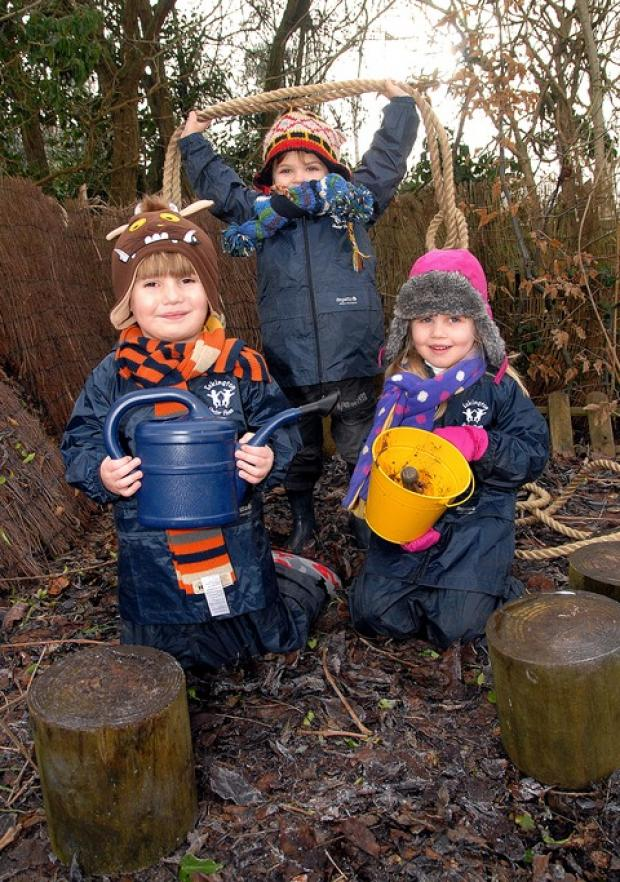 Cotswold Journal: OUT AND ABOUT: Members of Eckington Under Fives Club enjoying their forest school. Harry Jones, back, Ernie Dorrell and Matilda White, all aged four.