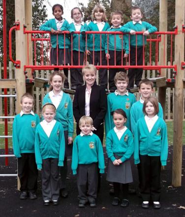 GOOD REPORT: Headteacher Faye Hemming with pupils.