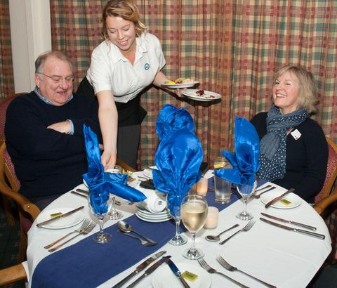 SERVICE: Catering manager Fiona Hirons serves Brian Collins and Jennifer Noble at the club's inaugural dinner