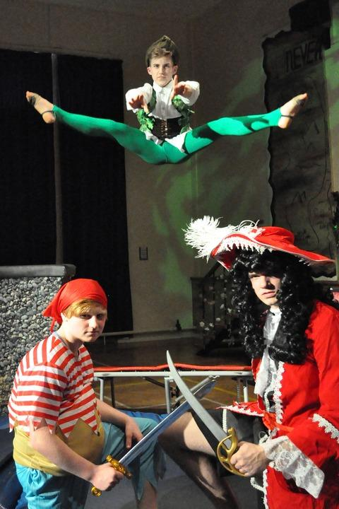 SWORDPLAY: Smee (Harvey Bridge-Edwards, aged 16) and Captain Hook (Rick Coleman, 17) with an airborne Peter Pan (Edd Birchmore, 15)