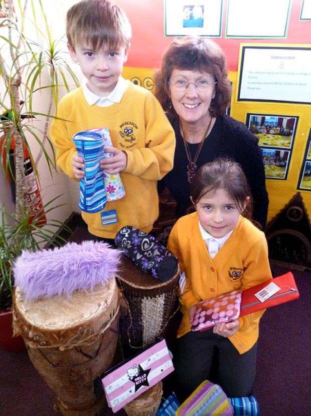 SCHOOL: Teacher Joan Humphreys and pupils Zia Larment and Louis Crook with pencil cases being sent to Zambia.