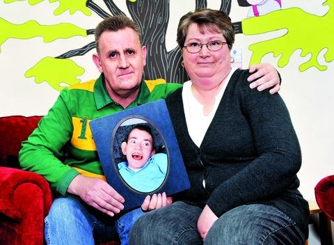 SUPPORT: Keith and Jane Allchurch with a photo of their son, Simon, who was one of the first young people to use Acorns Children's Hospice in Worcester when it opened in 2005.