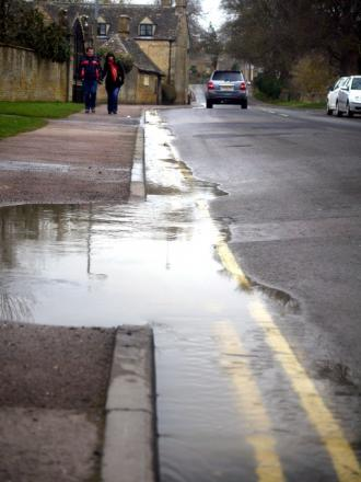 FOUL: Puddles of sewage on the streets of Bourton.