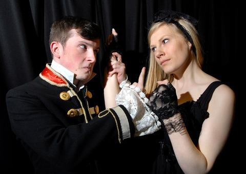 Ellis Tustin as Petruchio and Jess Dallard as Katherina in Prince Henry's production of The Taming of The Shrew.