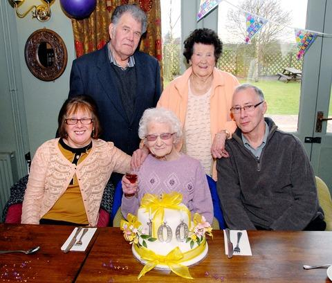 HAPPY BIRTHDAY: Stella Price, who has just celebrated her 100th birthday, with her daughter Margaret Westaway, left, son Ron Price, right, Thursday Club treasurer Don Tinson and Dot Bullock.