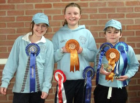 PRIZES: Croome Hunt Pony Club's Kate Saunders, Emily Turner and Robert Saunders. Picture: SARA TURNER