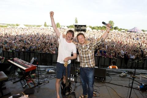 FESTIVAL FEELING: Alex James and Jamie Oliver on stage at last year's Big Feastival.  Picture by George Powell.