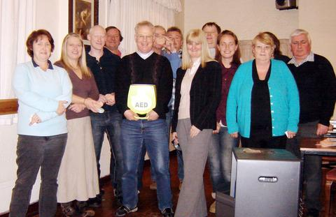 NEW KIT: Harvington vicar the Rev Richard Thorniley holding the defibrillator at the Coach and Horses.