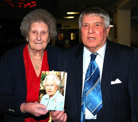 CARD: Ken and Jean Edwards proudly show off their greeting from the Queen to mark their diamond wedding anniversary.