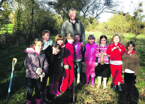 PUTTING DOWN ROOTS: Rainbows from Evesham had fun planting trees in the Church Lench community orchard.