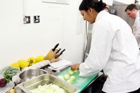 GOOD FOOD: MasterChef contestant Rukmini Iyer preparing a meal at Moreton Fire Service College.