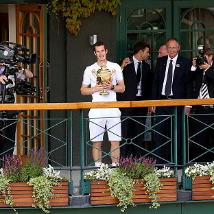 Leon Smith was 'thrilled' to see Andy Murray, centre, claim the Wimbledon title
