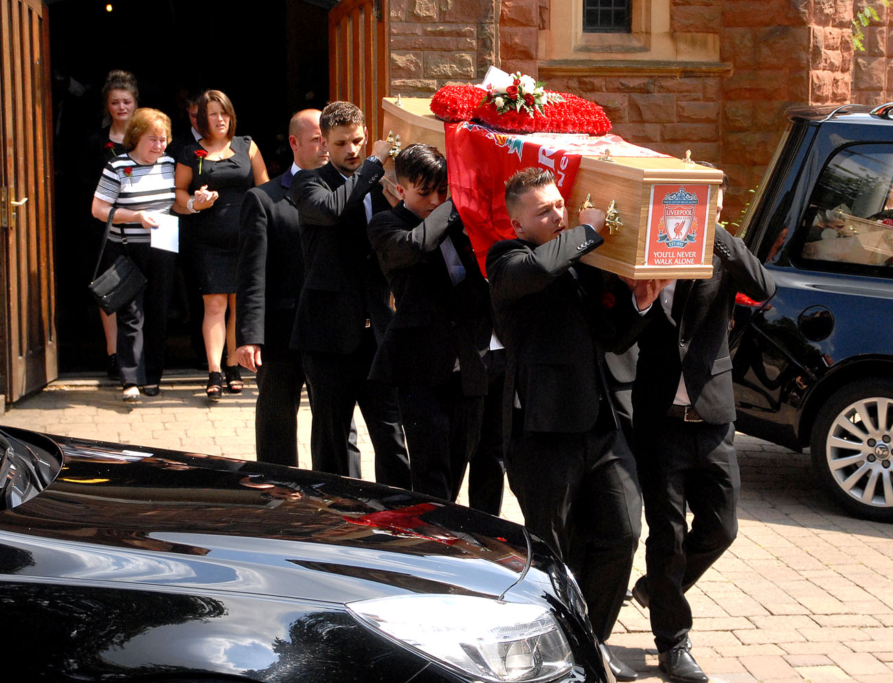 Family carry out the coffin at the funeral of Russell O'Neill