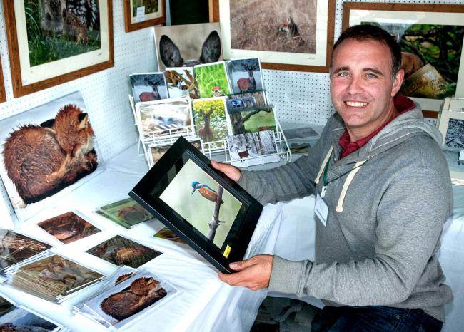 WILDLIFE: Adam Tatlow with a selection of his photographs