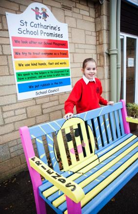 SITTING PRETTY: Phoebe Hope, who created the winning design for the new Buddy Bench at St Catharine's School, Chipping Campden.