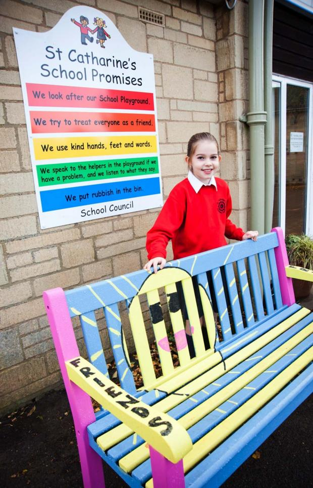 Cotswold Journal: SITTING PRETTY: Phoebe Hope, who created the winning design for the new Buddy Bench at St Catharine's School, Chipping Campden.