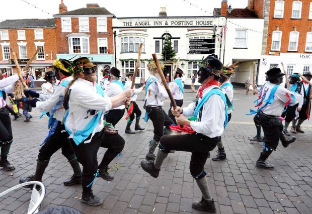 Cotswold Journal: GIVING IT SOME STICK: The Original Welsh Border Morris performing in the centre of Pershore during the festive period.