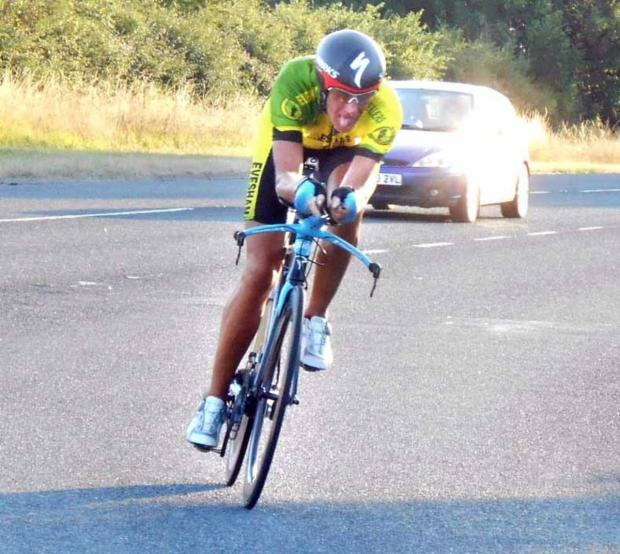 ON HIS BIKE: Evesham's Simon Wix clocks up the miles as he won the Strava challenge. Picture: STEVE TARLING