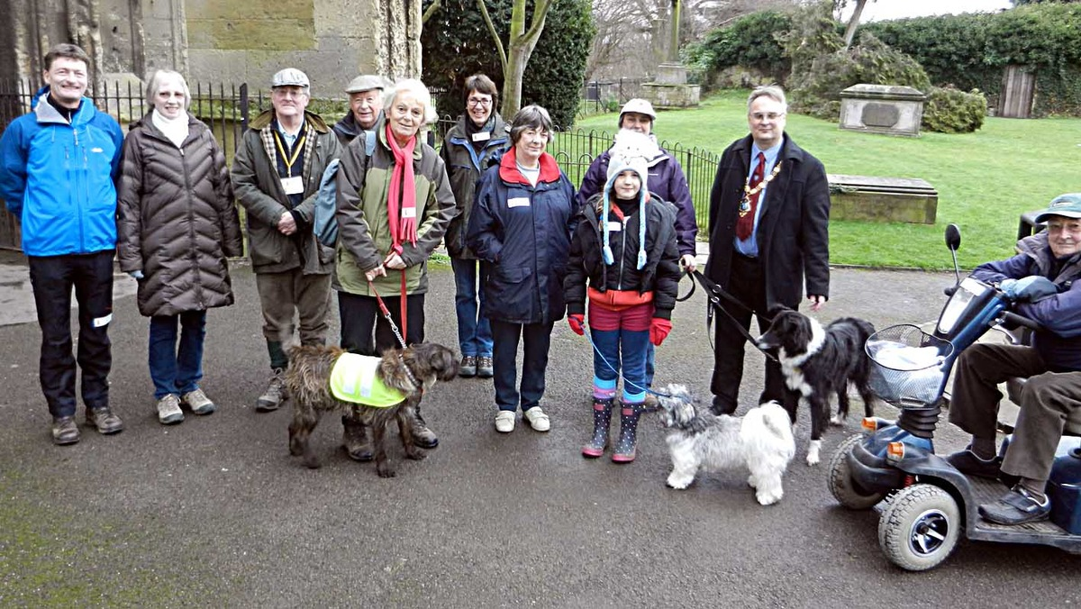 Spike the dog, centre, wearing a natty yellow jacket, marshalls his troops before setting off on a sponsored walk in aid of the Bell Tower on Sunday. The event was the first fund-raiser of 2014.