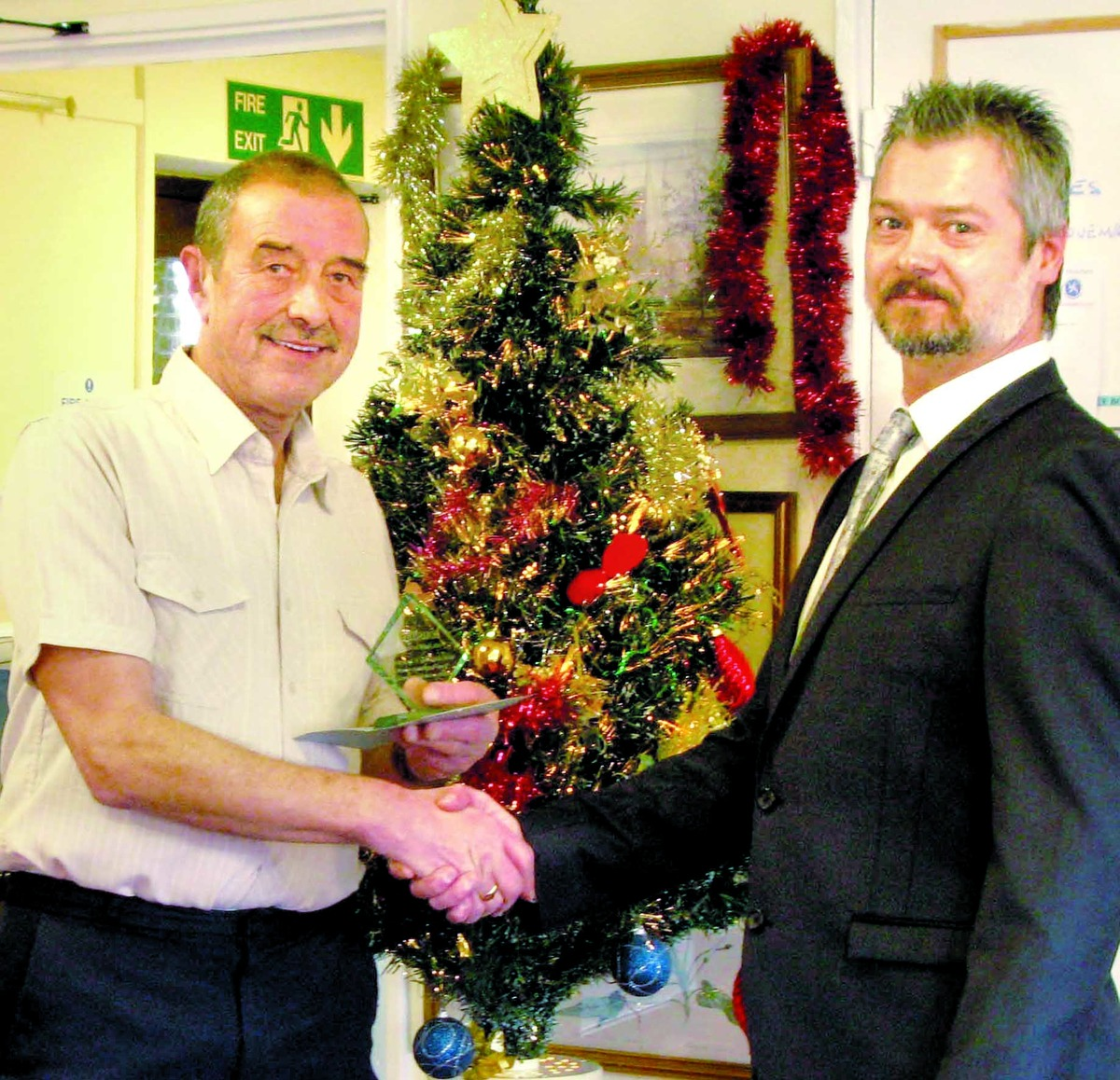AWARD: Ivan Easterbrook, left, receives trophy from Andy Jennings, Housing 21 manager.