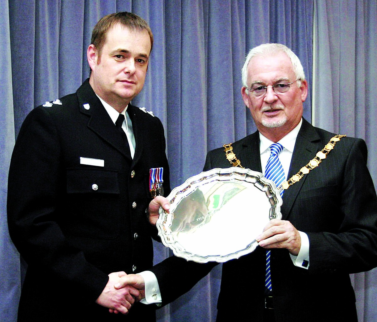 THANKS: Inspector Sean Kent receives his award from Wychavon chairman Gerry O'Donnell.