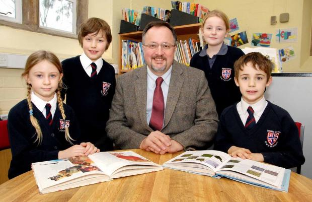 TOPS: Temple Guiting School has excelled in league tables. From left, Edie Pollock, aged eight, Luke Walkingshaw, 11, headteacher David Ogden, Hannah Robbins, nine, and Toby Selleck, eight.
