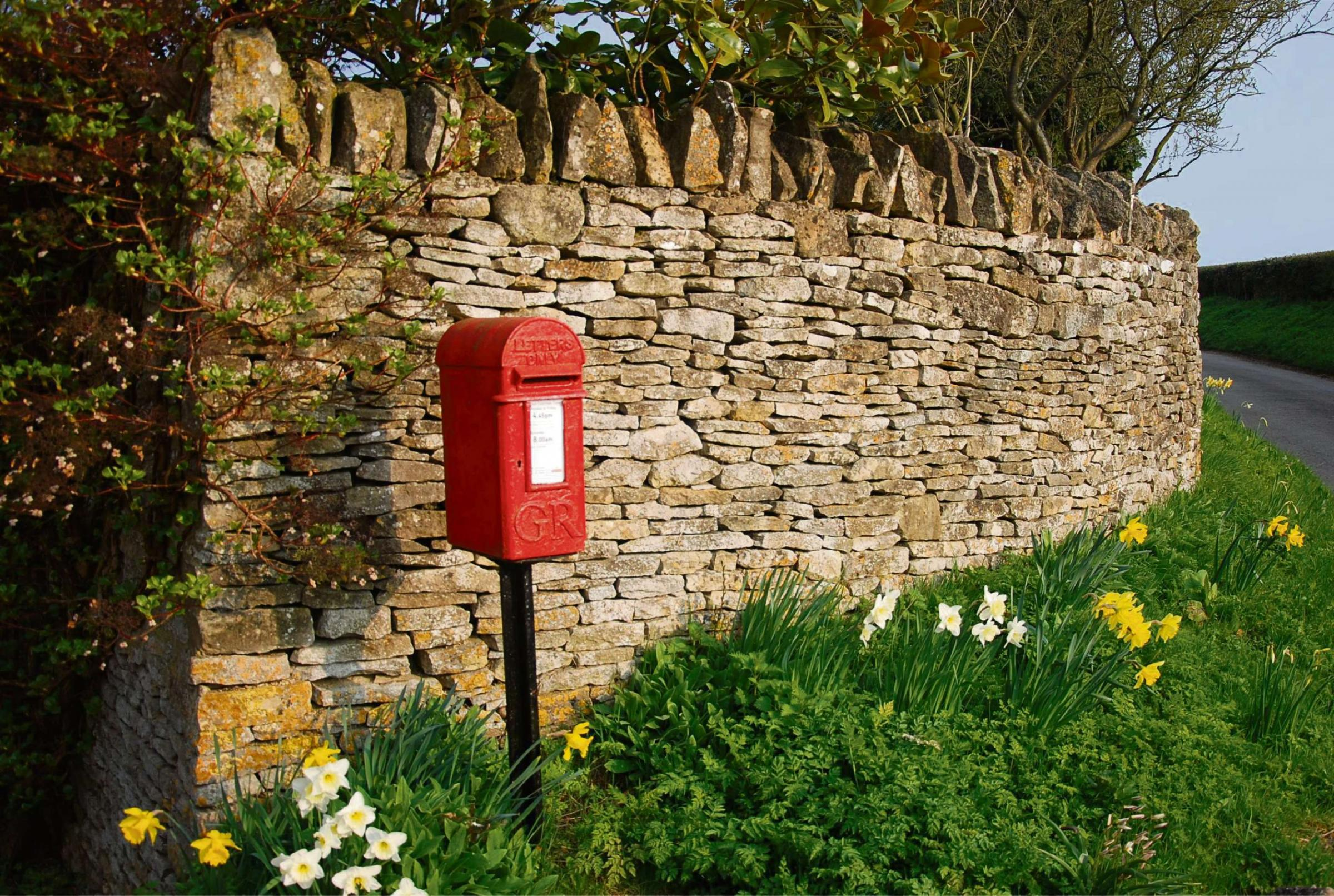 A traditional red post box surrounded by daffodils in Clevely taken by amateur photographer Paul Chapman, of Enstone, who was the winner of the 2013 Oxfordshire Cotswolds Photographic Competition