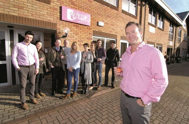 Business open day at Thomas Cleaning in Chipping Norton. Company owner RICHARD THOMAS, far left with staff and clients. Picture by Nick Toogood. (3471768)