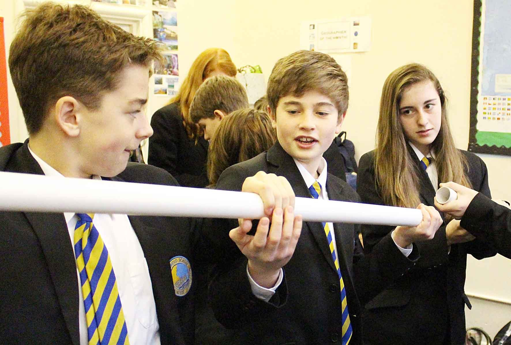 CHALLENGE: Students Johnnie Parker, Robbie Lord and Faye Conisbee exercise their teamwork skills with other Year 9 pupils considering how they might pipe clean water across a disaster-struck area as effectively as possible.