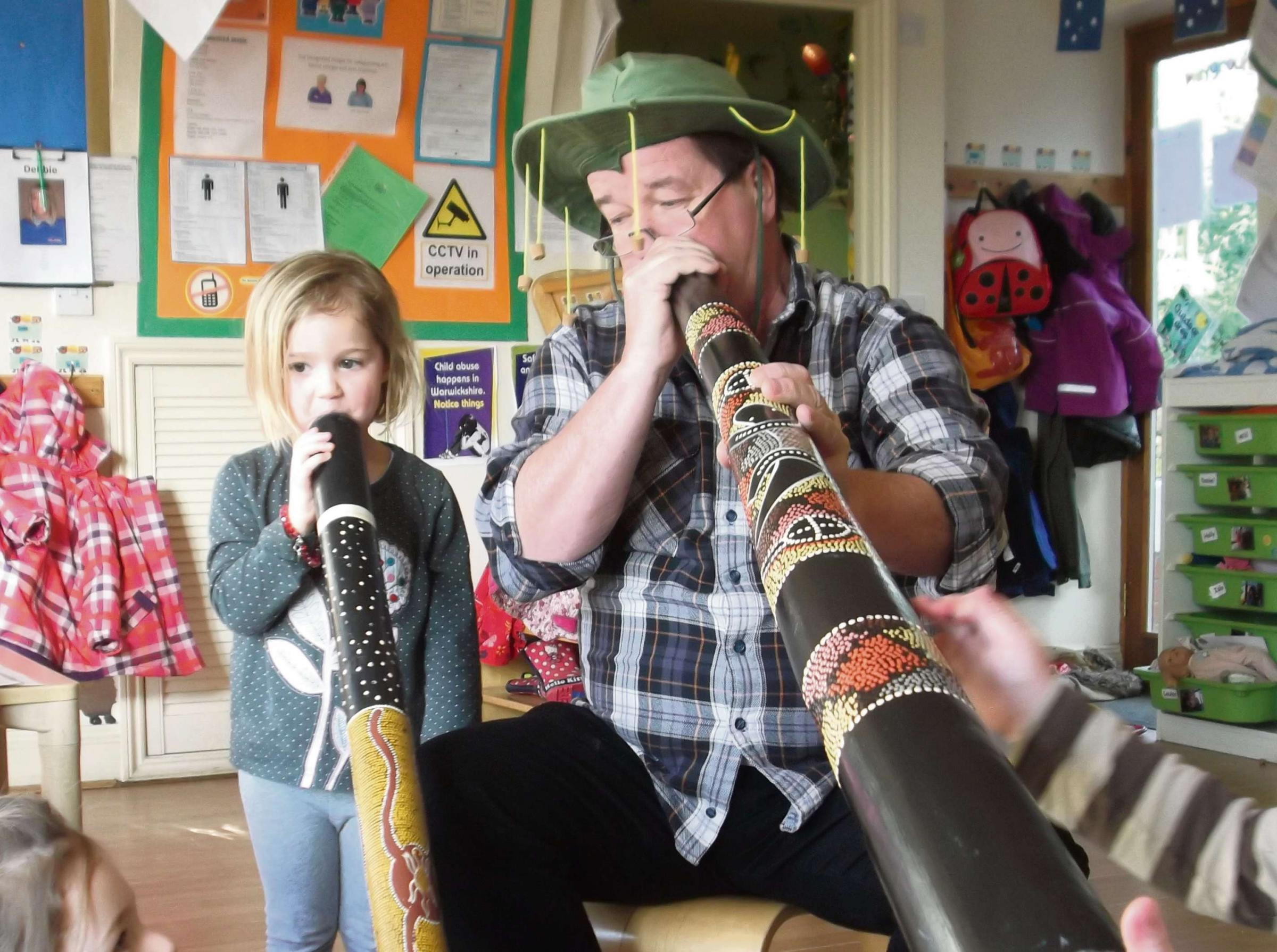 Grace Conway, aged 3, learning to play the didgeridoo with Steve Taylor, who learnt to play the didgeridoo while travelling in Australia 10 years ago.