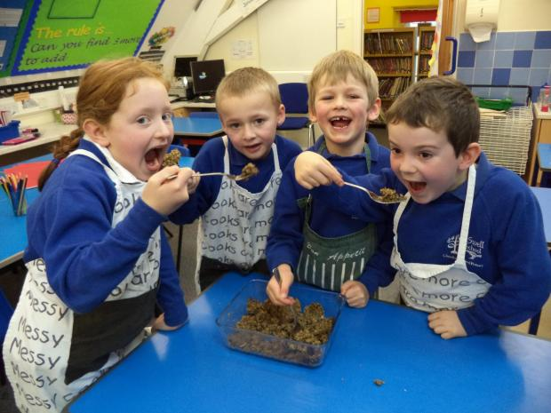 l-r Lexie Young (7), Oliver Coleman (6), Peter Fletcher (6), Tobi Hunt (6) all sampling the haggis.