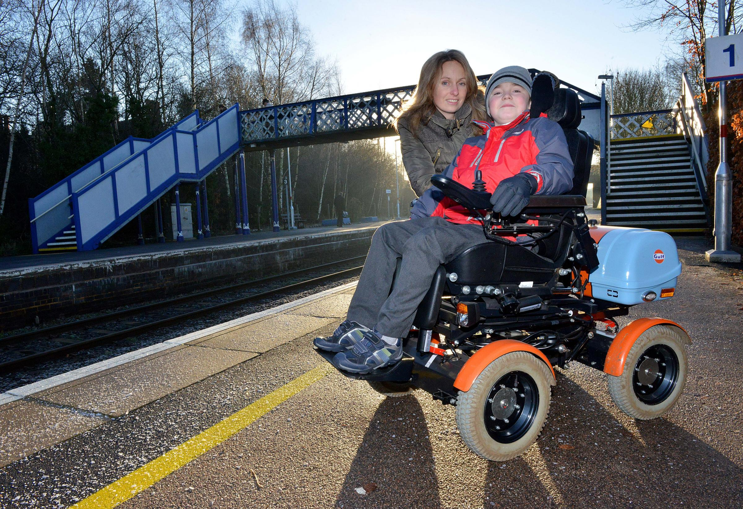 CAMPAIGN: John Dickson, 10, and his mother Angela at Kingham Station. The station is the only one on the Cotswold Line without step-free access. Picture by Simon Williams