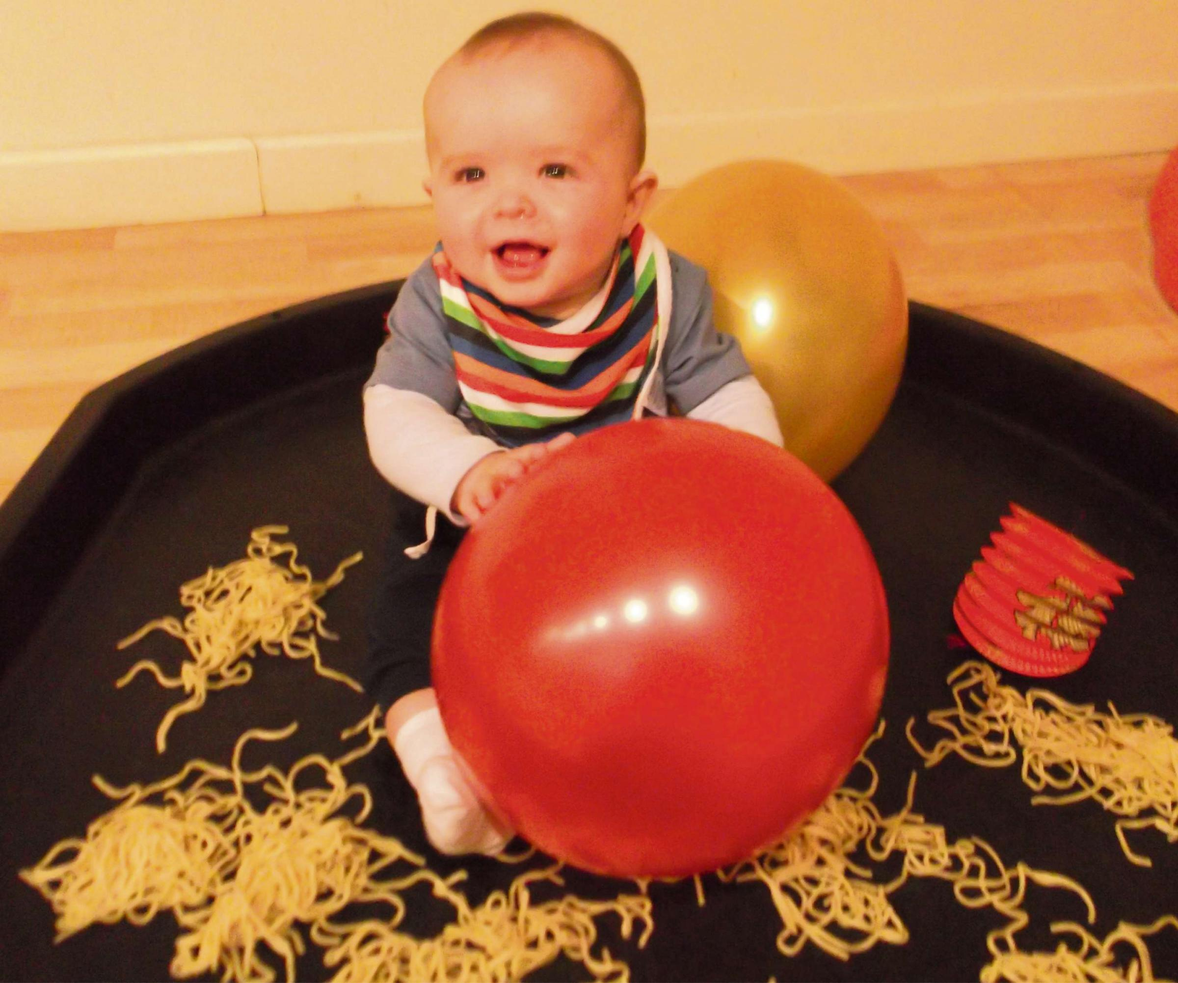 Tobias Satchwell, aged 7 months, from Winchcombe Farm's hatchery room enjoys noodle play to c