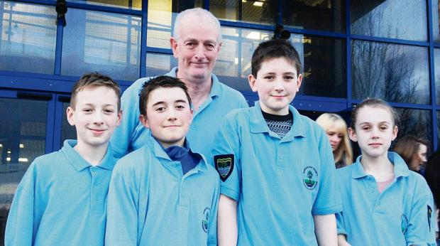COUNTY ACES: Chris Vizard, William Gearey, Simon Sweatman and Isabella Woodcock with Pershore Swimming Club head coach Tom Naughton. Picture: TIM GEAREY.