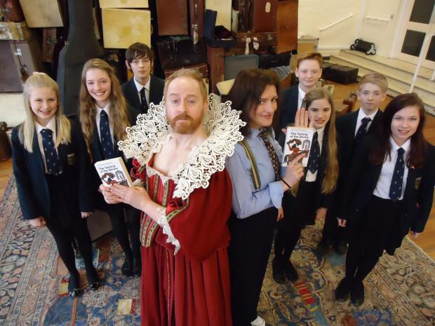 Forbes Masson (who plays Katherine) and Katy Stephens (who plays Petruchio) with pupils from Shipston High School.