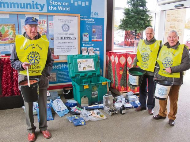 Rotariand Barry Peaston, Ernie Rumsey and Alan Holmes collecting for the Philippines appeal